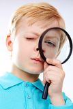 Looking through magnifying glass Stock Photos