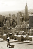 Looking at Manhattan. Child looking at midtown Manhattan from Rockefeller center observation desk Royalty Free Stock Images