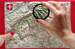 Vacation in Switzerland. Looking on the map holiday destination. Vacation in Switzerland. Preparing and looking on the map for the upcoming holiday location Stock Images