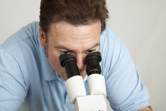 Looking Through Microscope Stock Images