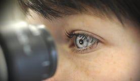 Looking in microscope stock photo