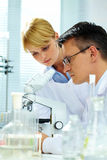 Looking in microscope Royalty Free Stock Photos