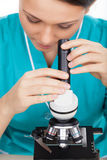 Looking through microscope. Royalty Free Stock Photography