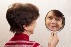 Looking at the mirror Stock Photo
