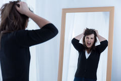 Looking at the mirror and shouting Royalty Free Stock Images