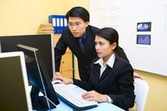 Looking at the monitor screen Royalty Free Stock Image