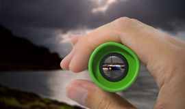 Looking through monocular at boat Royalty Free Stock Photos