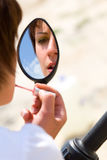 Looking at motorcycle mirror Stock Images