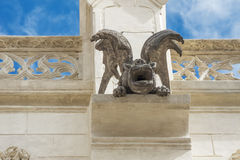 Looking into the mouth of a demonic gargoyle. Metal wires are necessary to keep the ornament together Royalty Free Stock Photography