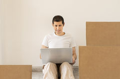 Looking for a moving company online Stock Photo