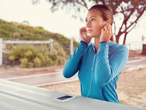 Looking for a music to get inspired for a run Stock Images