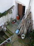 Looking into neighbours yard. Looking into neighbours untidy yard in Andalusian village Stock Photography