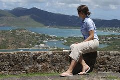 Looking At Nelson's Bay. The girl enjoys the view of Antigua island (Antigua & Barbuda Stock Photography