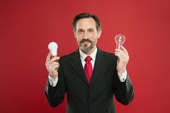 Looking for new ideas. Power saving. Male in business outfit. Businessman in suit hold light bulb. Electricity and. Energy. Man with beard search for royalty free stock photo