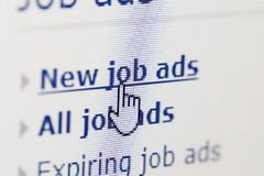 Looking for new job on internet ads Royalty Free Stock Image