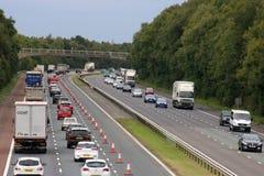 Heavy traffic M6 motorway near Scorton, Lancashire. Looking North along the M6 motorway near Scorton in Lancashire with heavy traffic in both lanes of the stock photos