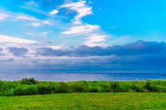 Looking ocean view form the shore. The beautiful ocean view form the shore and clear sky Stock Image