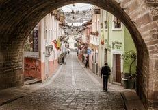 A Cityscape of Quito, Ecuador. Looking through an old arch into the city of Quito, Ecuador Royalty Free Stock Photo