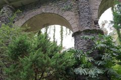 Looking at an old arch from green park. This scene was taken near to the Church of our Lady of Monte in Nossa Senhora Do Monte, Madeira, Portugal stock photo
