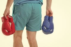 Looking for opponent. Man in shorts carries two pairs boxing gloves rear view isolated white background. Equipment royalty free stock image