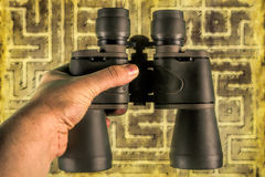 Looking for opportunity. Binoculars helping to see opportunities on the maze of things Royalty Free Stock Image
