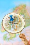 Looking in on Oslo, Norway, Europe. Blue tack on map of Scandinavia with magnifying glass looking in on Oslo, Norway Stock Photography