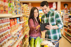 Looking at our shopping list Stock Photography