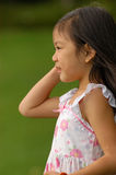 Looking Out. Young chinese girl looking out Royalty Free Stock Image