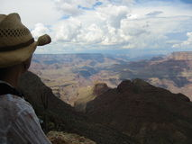 Looking out. Woman looking over Grand Canyon Royalty Free Stock Images