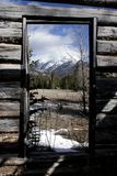 Looking out. View from inside the Moberly homestead in Jasper National Park Royalty Free Stock Image