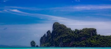 Looking out at the bay at Phi Phi Island, Krabi Thailand. Looking into the bay at Phi Phi Island. There is a mountain on the other side of the water. The clouds royalty free stock images