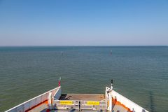 A View from a Ferry  leaving the Isle of Wight. Looking out from a car ferry over the Solent, leaving   Fishbourne on the Isle of Wight and heading towards royalty free stock image