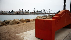 Looking out on harbor behind bench stock video
