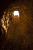Looking Out of Mine Portal. Underground Cave looking out to sky light Royalty Free Stock Photos