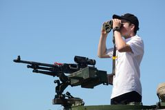 Looking out at open day for army. GREYMOUTH, NEW ZEALAND, NOVEMBER 18, 2017: An unidentified schoolboy scans the horizon with binoculars at an open day run by Stock Image