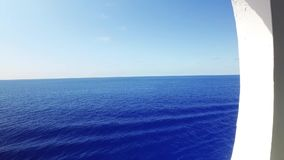 Looking Out at Sea from Cruise Ship Porthole. 8898 Looking out at the open ocean from a cruise ship`s porthole stock video footage