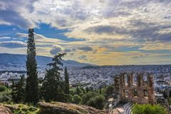 Looking out over the cityscape of Athens and over the Odeon of Herodes Atticus from the Acropolis near sunset stock photo