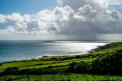 Looking Over the Countryside of Ireland. Looking out over the countryside of Ireland and seeing this storm over the Atlantic Ocean as the sun is still shining it Royalty Free Stock Photography