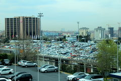 Looking out over parking lot and skyline,Istanbul Ataturk Airport,Turkey,2016. Impressive view of skyline and parking lots, seen from windows of Istanbul Ataturk Stock Photo