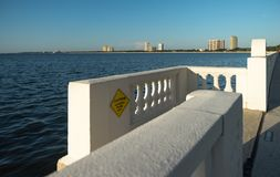 Tampa seawall with stairs leading to water stock photography