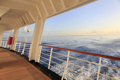Looking out the Stern of a Cruise Ship as the Sun sets Royalty Free Stock Photos