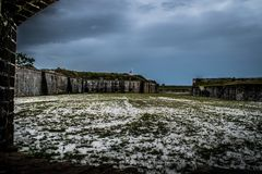 Looking out at storm brewing over the abandoned Fort Pickens site. Storm brewing over the abandoned Fort Pickens site Stock Images