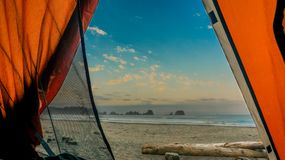 Looking out from a tent at the beach and ocean royalty free stock images