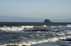 Looking out to Bass Rock. Bass Rock and sea waves from east coast Stock Photos