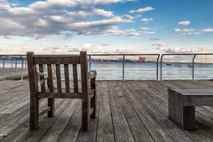 Looking out to Sea. A chair in a dock looking out to sea Stock Photos