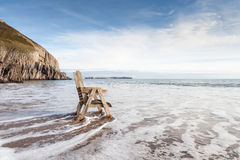 Looking out to sea. Chair at the sea shore looking out to sea Stock Photos