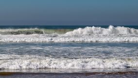 Atlantic Ocean waves breaking on the sand beach at Agadir, Morocco, Africa stock images
