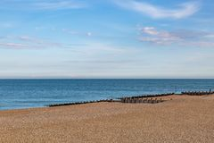 Eastbourne Beach. Looking out to sea over the pebble beach at Eastbourne stock images