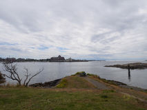 Looking out towards the harbour entrance of victoria. Entrance to the Victoria Harbour on a cloudy day looking out to the cruise ship dock Royalty Free Stock Photography