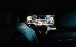 Looking out from Vietnam taxi. Hanoi, Vietnam - September 20, 2016: Low key photo of looking out from Vietnam taxi to busy night traffic of Hanoi's down town Stock Image